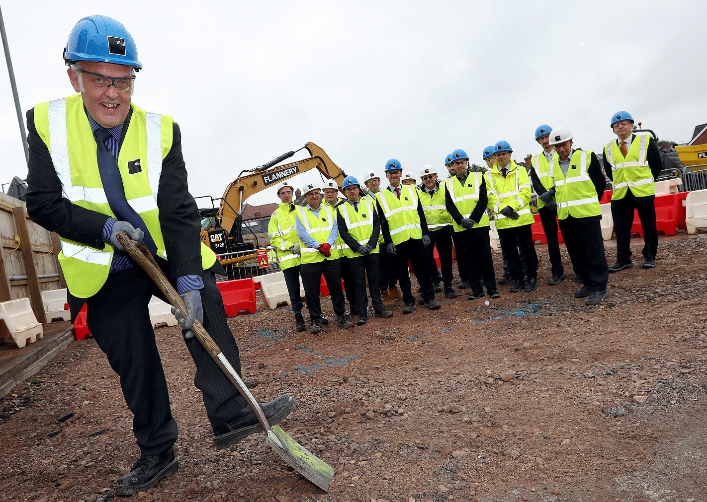 Brian Taylor, Chair of Birmingham Community Leisure Trust breaks the first ground at the site of Erdington's new leisure centre watched by representatives of BCLT, Birmingham City Council, ISG Construction plc and Sport England