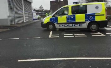 A man has been arrested on suspicion of murder after the body of a woman was found in a car park