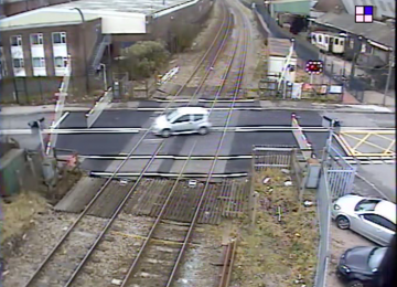 Motorist caught swerving around safety barriers at Langley Green level crossing.