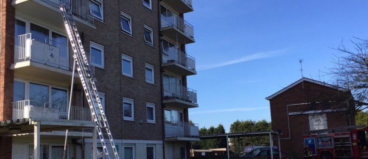 Four people including two young children rescued from a flat fire in Sutton Coldfield.