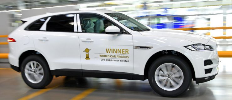 JLR workforce celebrates F-Pace being named as the best car in the world.