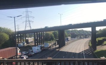 Aston Expressway and M6 closed during morning rush hour after a woman was spotted on bridge.