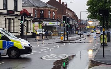 Stratford Road cordoned off after a man suffered a gunshot wound to the shoulder.