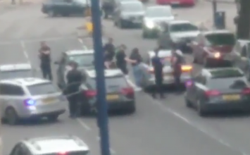 Armed officers intercept a taxi in Moseley following reports of passengers with a firearm.