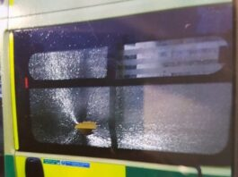 Smashed window on an Ambulance which has now been taken off the road for repairs