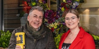 Mark Gribben, owner of Ethos, with Lydia Collins holding the